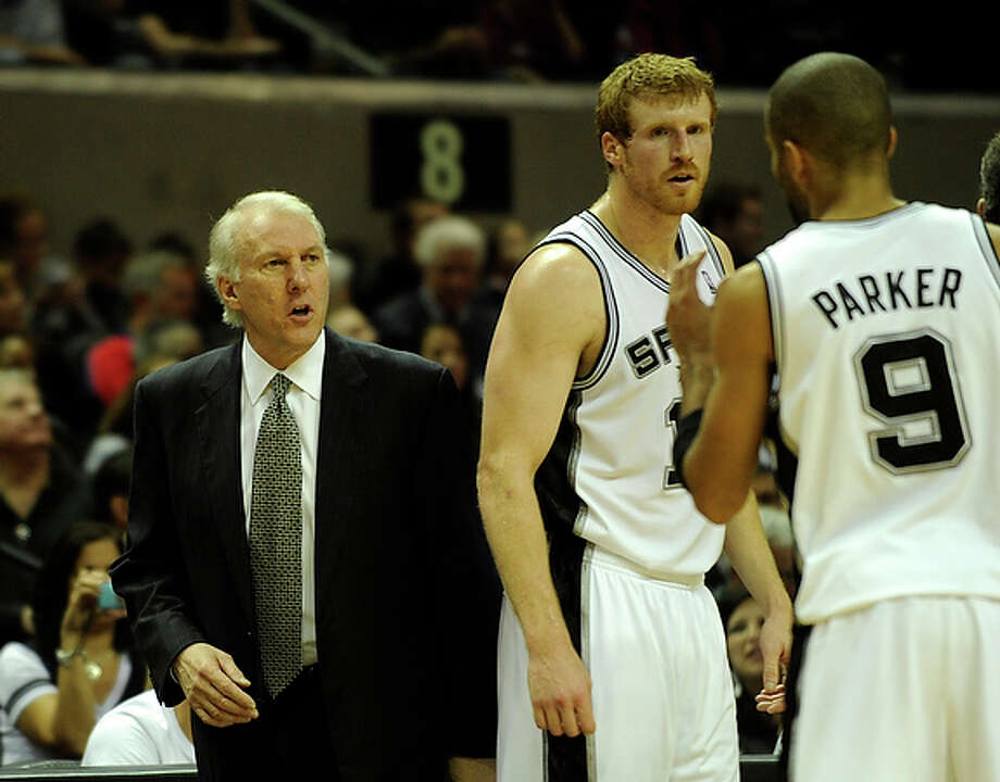 San Antonio Spurs coach Gregg Popovich watches the action on the court as his team takes on the Cleveland Cavaliers at the AT&T Center on Saturday, Nov. 20, 2010.