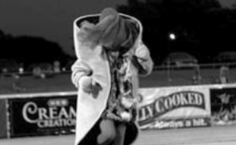 Henry the Puffy Taco rounds third during a Missions game two seasons ago. But the race finished the same as always: The kid won.