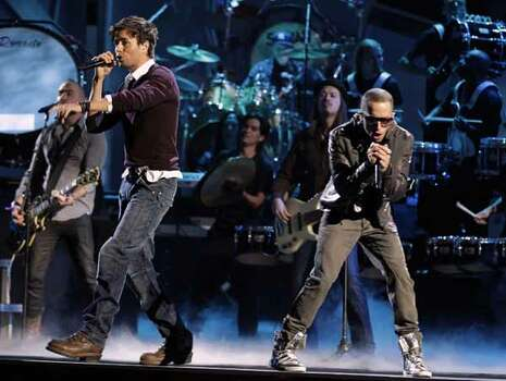 Yandel, right, performs with Enrique Iglesias onstage at the 11th Annual Latin Grammy Awards on Thursday, Nov. 11, 2010, in Las Vegas.