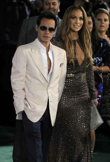 Marc Anthony, left, and Jennifer Lopez arrive at the 11th Annual Latin Grammy Awards on Thursday, No