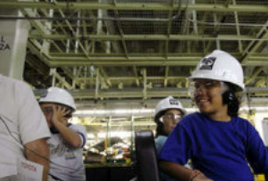 Eight-year-old Mishiella Dames and fellow classmates from Trinity United Methodist School take in Toyota's 2.2-million-square-foot Tundra assembly plant during a field trip.