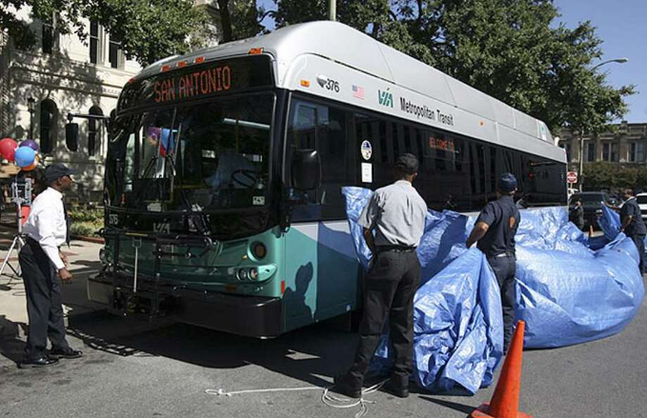 A new VIA bus powered by diesel-electric hybrid technology is unveiled Monday at City Hall.
