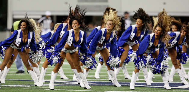 The Dallas Cowboys Cheerleaders perform. / eaornelas@express-news.net