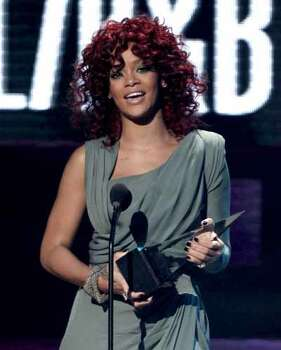 Rihanna accepts the award for soul R&B favorite female artist at the 38th Annual American Music Awards on Sunday, Nov. 21, 2010 in Los Angeles.