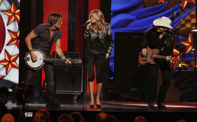 Carrie Underwood, Brad Paisley and Keith Urban perform at the 44th Annual Country Music Awards in Nashville, Tenn., Nov. 10, 2010.