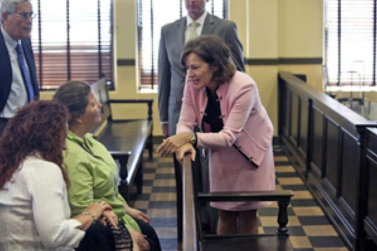 Judge Sharon Keller (right) talks to Marijo (left) and Paula Dixon, daughters of the victim in the Michael Richard case, during Keller's ethics hearing in 37th Distrcit Court on Thursday.