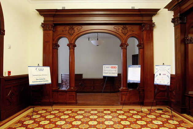 The University Welcome Center is to the left of the foyer. The wood archway was made by local artisan, Roman Pena. At some point in the history of the building, the archway was replaced by a wall. / glara@express-news.net