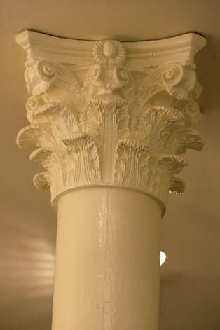 A corinthian capital on one of the supports columns on the first floor the building. The capitals were hidden by dropped ceilings and discovered during the construction. / glara@express-news.net