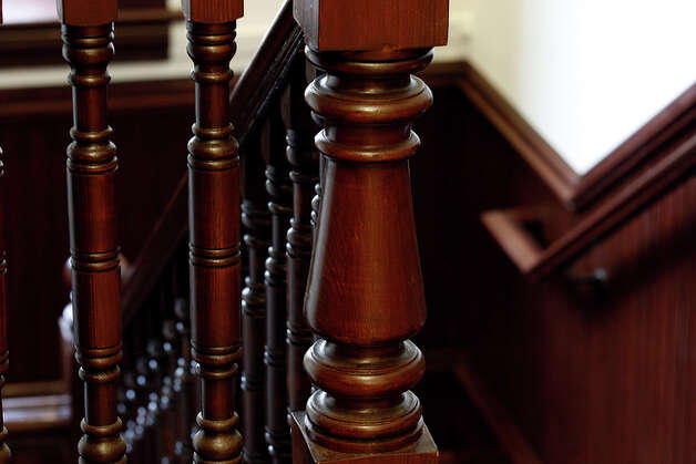 The Newel post and balusters shine on one of the staircases. Wood from other parts of the building was used to replaced damaged parts of the staircases. / glara@express-news.net