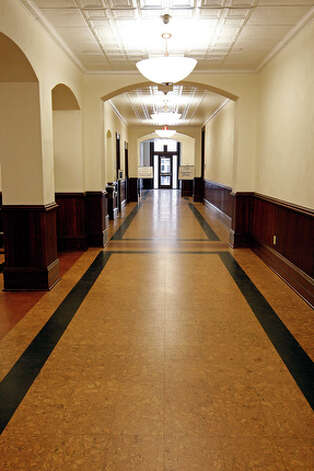 Cork flooring was used on the second floor hallway and the hallways of the upper floors of the Main Building. / glara@express-news.net