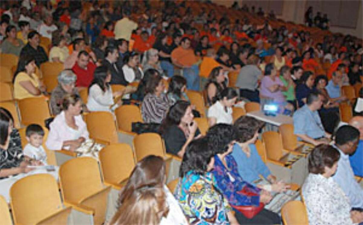 Members of the community, await the presentation of the superintendent's goals for the community as the district reviews three proposals that could close between 15 and 19 schools, the meeting took place Sept. 1, in the auditorium of Burbank High School.