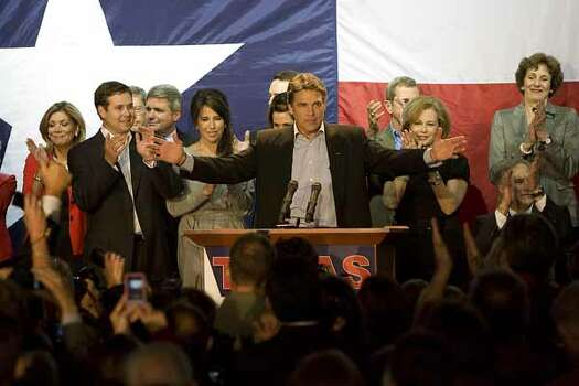 Texas Governor Rick Perry celebrates  his re-election on stage with his family and other office holders who won re-election during his acceptance speech in Buda, Nov. 2, 2010.
