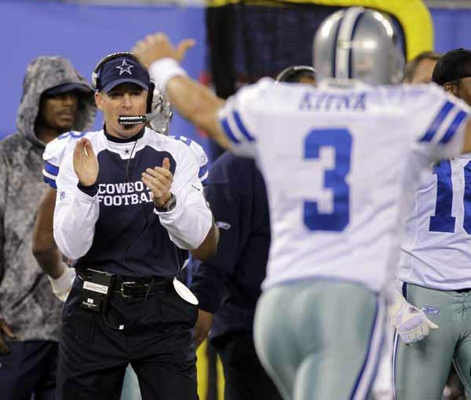 Dallas Cowboys interim coach Jason Garrett and quarterback Jon Kitna (3) react during the second quarter of an NFL football game against the New York Giants at New Meadowlands Stadium, Nov. 14, 2010, in East Rutherford, N.J.