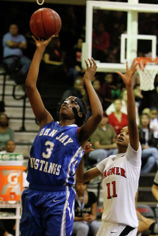 John Jay's Aleeya Harris (03) gets a rare open look at the basket against Wagner's Eboni Watkins (11). / kmhui@express-news.net