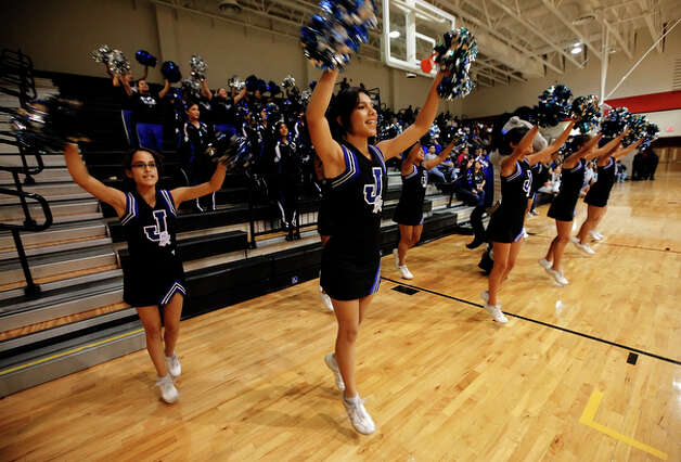 John Jay cheerleaders make their presence known in the season opener of girls high school basketball at Wagner. / kmhui@express-news.net
