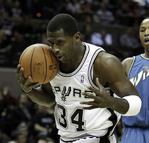 Antonio McDyess grabs a rebound against the Wizards on Nov. 21.