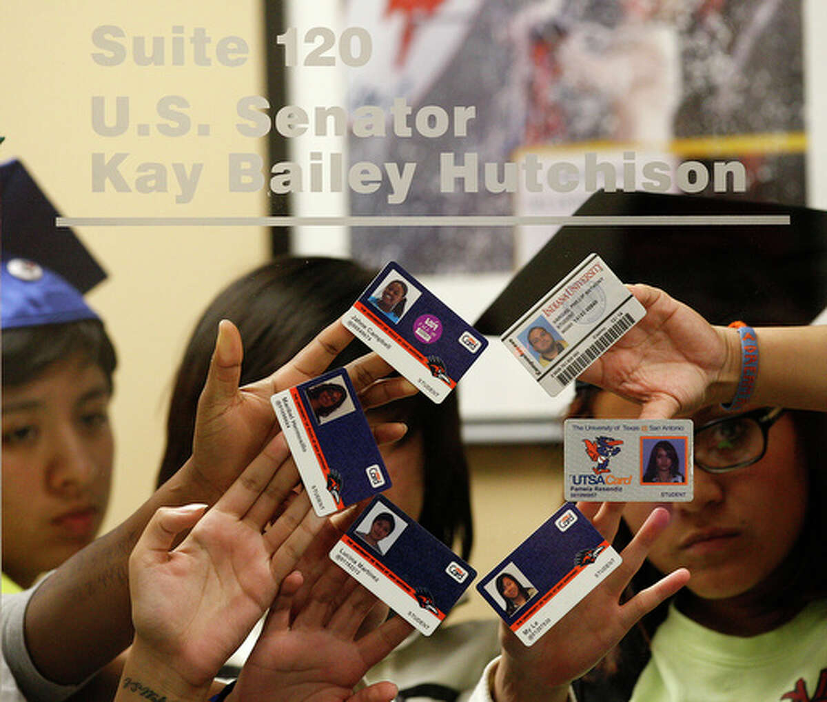 DREAM Act supporters show off their student cards.