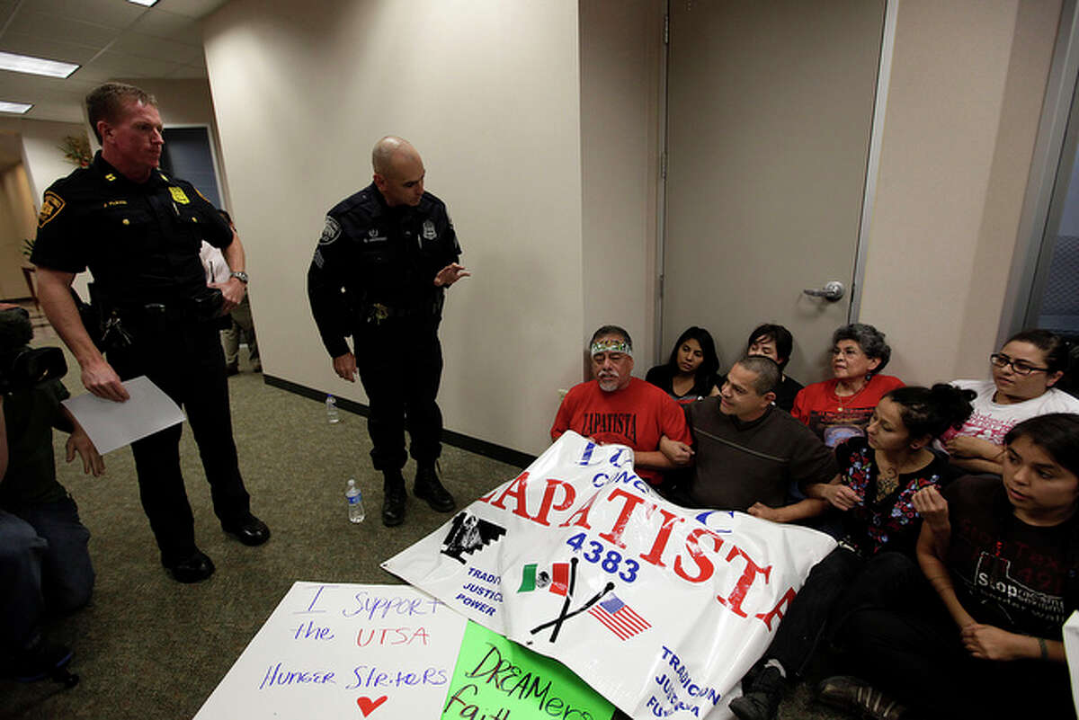 San Antonio Police warn DREAM Act supporters before they were arrested.