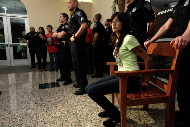 DREAM Act supporter Yasmina, (no last name given) sits down after she was arrested. She was on her twentieth day of a hunger strike. / glara@express-news.net