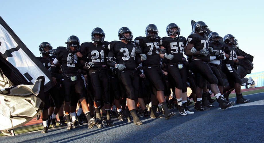 Members of the Steele Knights football team take the field against  the McAllen Memorial Mustangs Friday Nov. 26, 2010 at the Student Activity Center in Laredo, Texas. Steele won 48-31. / eaornelas@express-news.net
