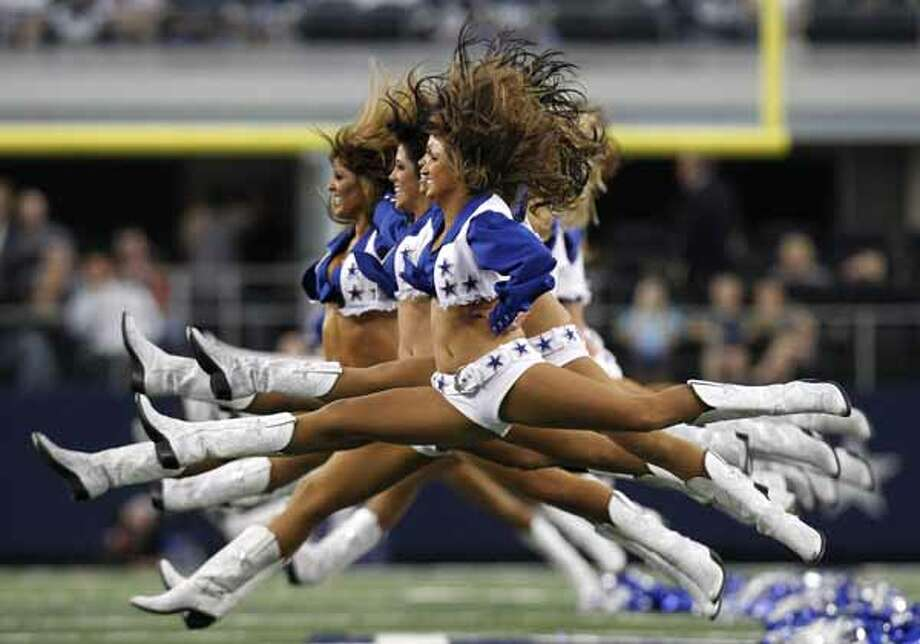 Members of the Dallas Cowboys cheerleaders perform before the start of an NFL football game against the Detroit Lions, Nov. 21, 2010, in Arlington.