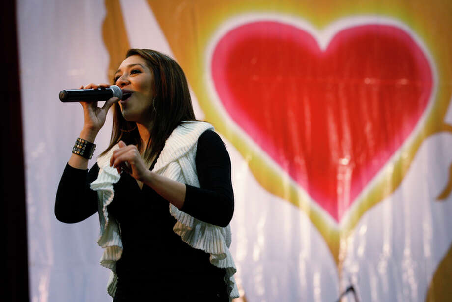 Erica Gonzaba performs at the annual Raul Jimenez Thanksgiving Dinner. / glara@express-news.net