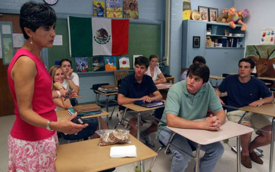 Alamo Heights High School Spanish teacher Melva Manzke (left) teaches class in the Spanish Immersion program. There is a long waiting list for student interested in enrolling in the program, which is gaining popularity.