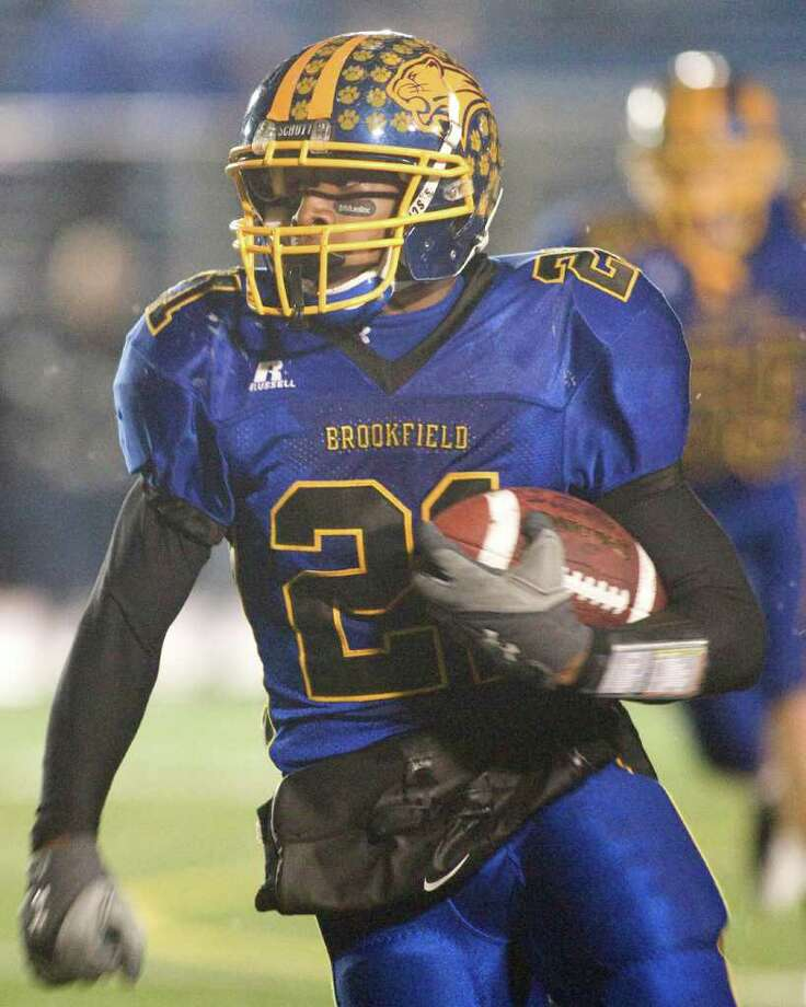 Brookfield's Leaon Gordon picks up a first down after catching a pass in the Bobcats' Class M state tournament quarterfinal game against Lyman Hall Tuesday night, Nov. 30, 2010, at Brookfield High School. Photo: Barry Horn / The News-Times Freelance