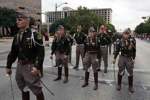 Hours before the Aggies face the Longhorns, the Texas A&M cadet corps marches down Congress Avenue on its way to the Capitol in Austin, Nov. 25, 2010.