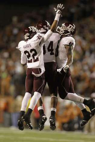 Texas A&M Aggies defensive end Von Miller (40) celebrates with teammates after he grabbed an interception near the Longhorns endzone stopping their drive late in the fourth.