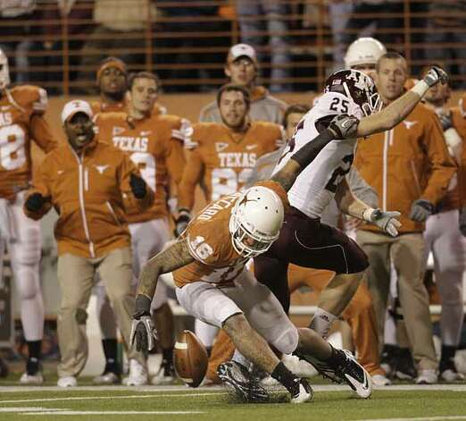 Texas Longhorns safety Kenny Vaccaro (16) tries to grab a pass intended Texas A&M Aggies wide receiver Ryan Swope (25) during the second half. / Houston Chronicle