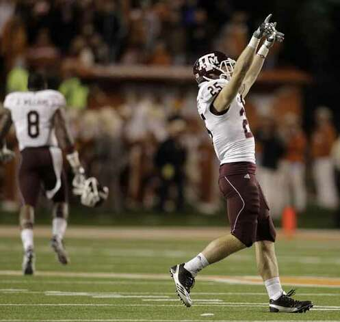 Texas A&M wide receiver Ryan Swope (25) celebrates on the field after the Aggies win over the Longhorns. / Houston Chronicle
