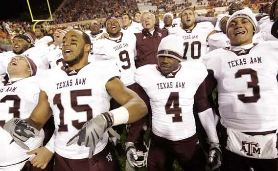 The Texas Aggies sing their school song after their win 24-17 over the Longhorns. / Houston Chronicle