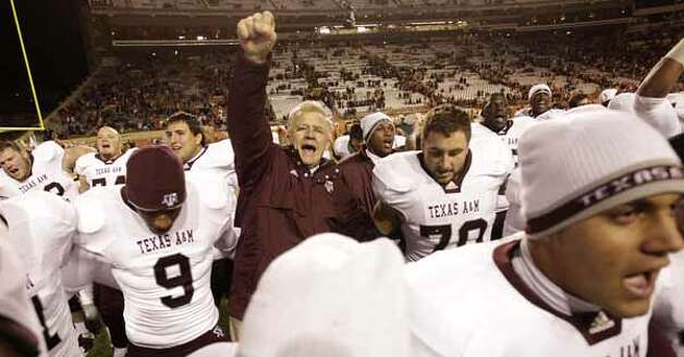 Aggies head coach Mike Sherman and his Texas Aggies sing their school song after their win over the Longhorns. / Houston Chronicle