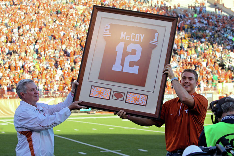 Mack Brown helps Colt McCoy hoist his retired jersey before the Texas Longhorns play the Baylor Bears at Texas Memorial Stadium on  Oct. 30,  2010.  Baylor stunned UT, 30-22. / © 2010 San Antonio Express-News
