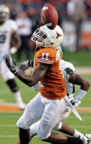 Texas receiver James Kirkendoll can't hang on to a hot pass in the first half. / © 2010 San Antonio Express-News