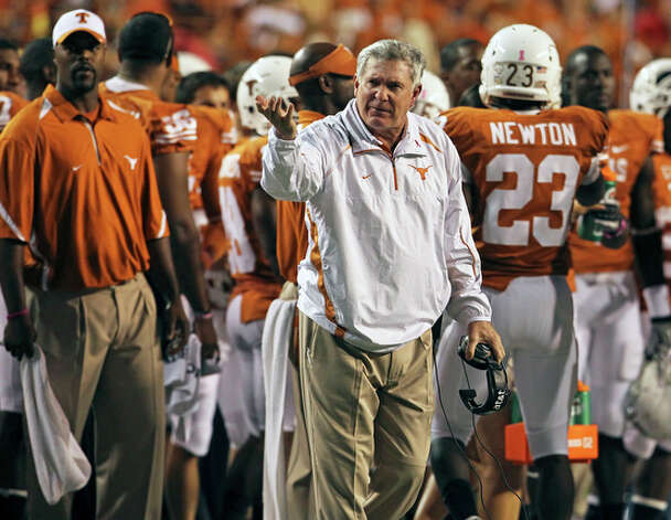 Mack Brown gestures to refs from the sideline. / © 2010 San Antonio Express-News