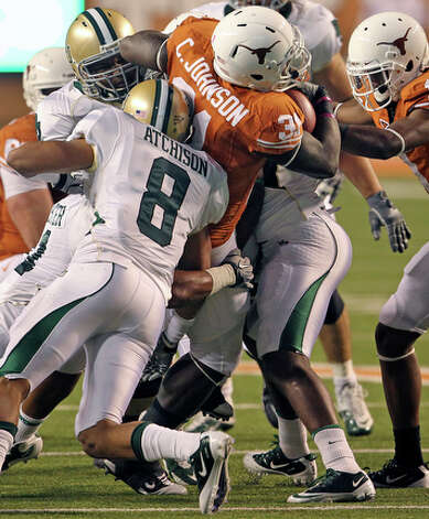 Texas running back Cody Johnson gets halted by Baylor in the interior. / © 2010 San Antonio Express-News
