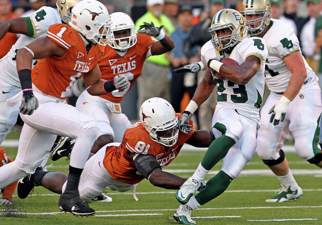 Baylor's Jay Finley busts through the Texas defensive line. / © 2010 San Antonio Express-News