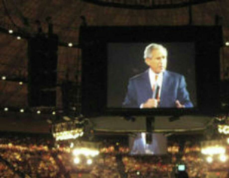 Former President George W. Bush speaks at a Get Motivated event at the Fort Worth Convention Center last month. He's also scheduled to appear in San Antonio.