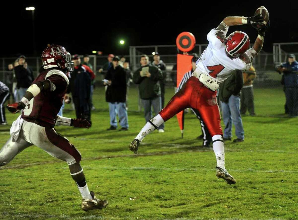 New Canaan's Kevin Macan makes a catch in the endzone for a touchdown during Tuesday's Class L quarterfinal game at Naugatuck High School on November 30, 2010.