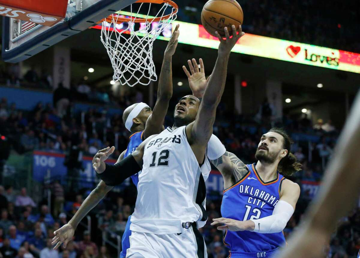 San Antonio Spurs guard Tony Parker goes up for a shot in front of (from left) Oklahoma City Thunder forward Serge Ibaka, Spurs forward Tim Duncan, and Thunder guard James Harden in the first quarter of an NBA basketball game in Oklahoma City, Sunday, Nov. 14, 2010. Parker led the Spurs with 24 points in the Spurs 117-104 victory.