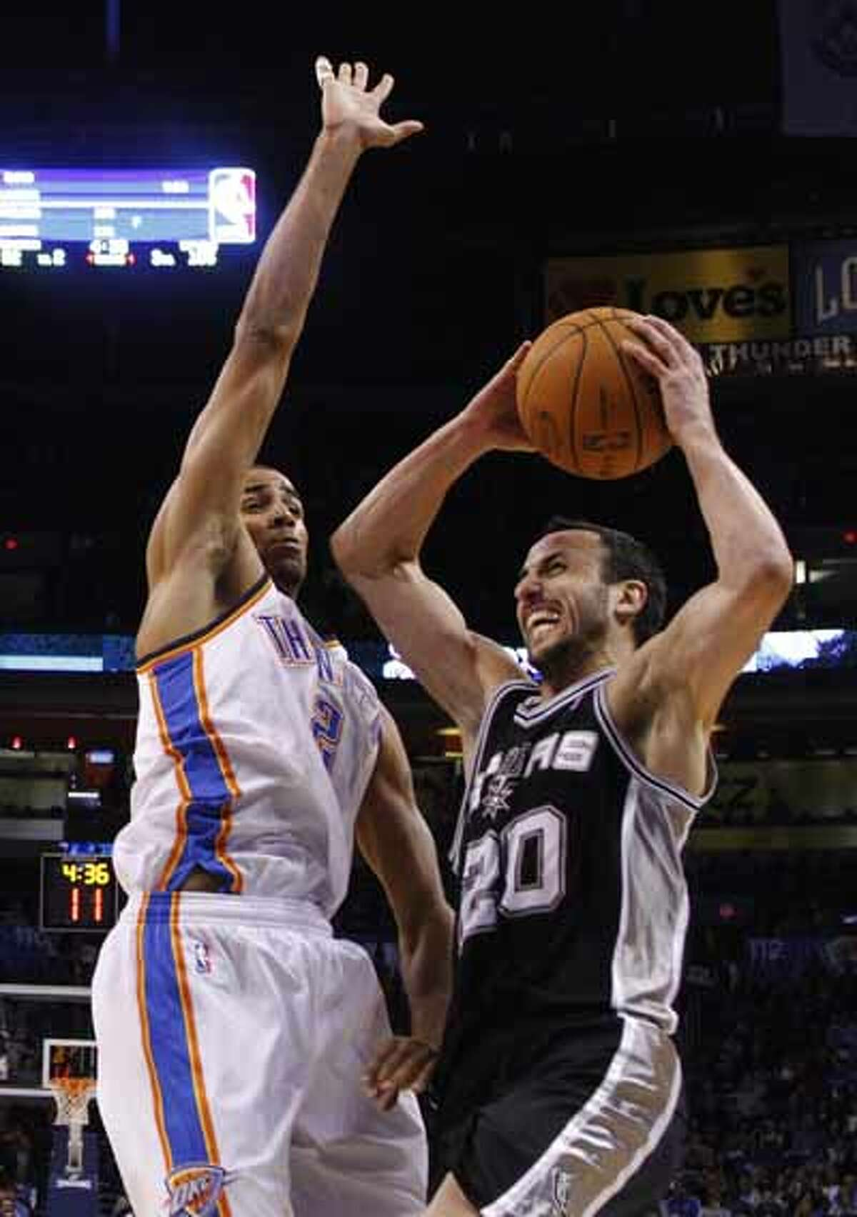 San Antonio Spurs guard Manu Ginobili shoots as Oklahoma City Thunder guard Thabo Sefolosha, of Switzerland, defends, in the fourth quarter of an NBA basketball game in Oklahoma City, Nov. 14, 2010. Ginobili had 21 points as San Antonio won 117-104.