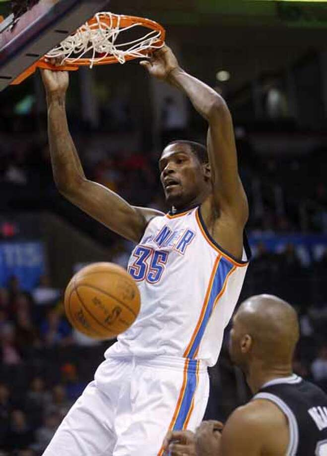 Oklahoma City Thunder forward Kevin Durant dunks against the San Antonio Spurs in the fourth quarter of an NBA basketball game in Oklahoma City, Nov. 14, 2010. Durant had 23 points for the Thunder, but San Antonio won 117-104.