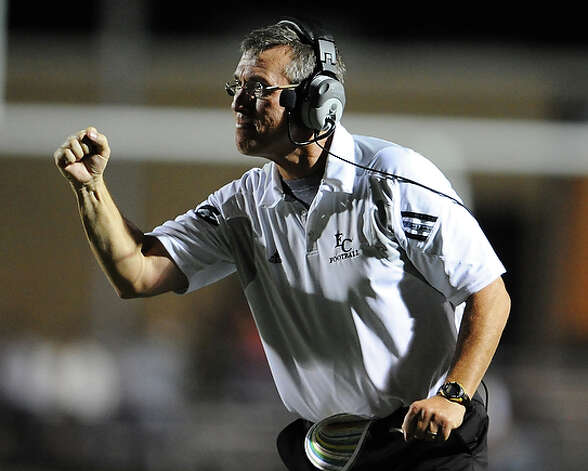 East Central head coach Robert Walker pumps his fist as his offense scores a touchdown. / San Antonio Express-News