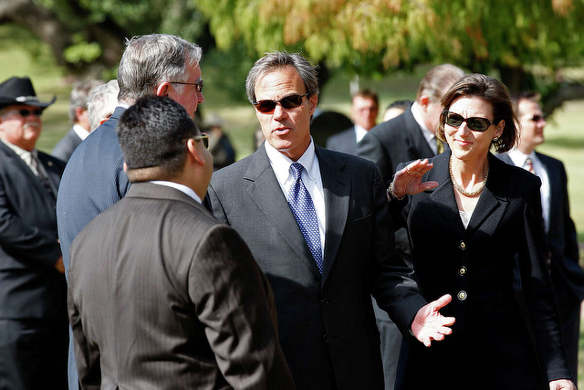 Speaker of the House Joe Straus and his wife, Julie, arrive for the burial service.