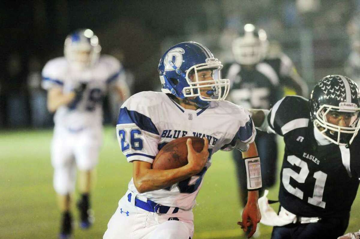 Darien's Peter Gesualdi carries as Darien High School faces Wethersfield in the football Class L State Quarterfinals in Wethersfield, Conn., Tuesday, November 30, 2010.