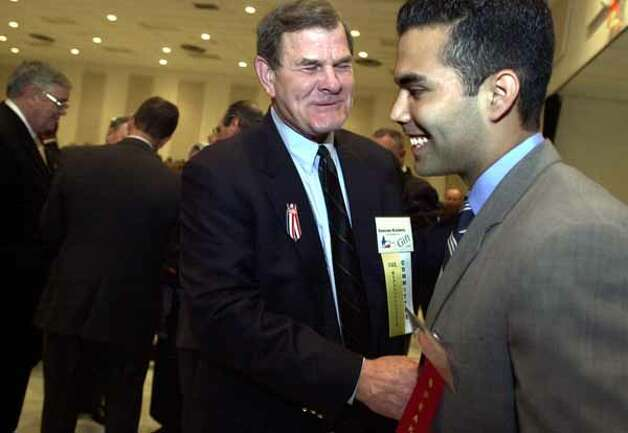 State representative Edmund Kuempel jokes with George P. Bush, President George W. Bush's nephew, who accepted the Texan of the Year award on his uncle's behalf March 21, 2002, at the New Braunfels Civic Center. / SAN ANTONIO EXPRESS-NEWS