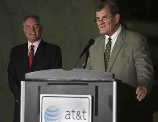 Peter Holt (left) listens at the AT&T Center Tuesday as State Representative Edmund Kuempel (right) makes the announcement that Holt has been named Texan of the Year by the Texas Legislative Conference, Dec. 22, 2009. / jdavenport@express-news.net