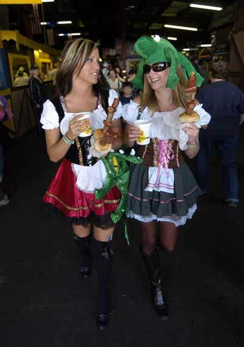 Shannon (left) and Amanda Smith stroll through Wurstfest with the traditional beer and sausages, Oct. 30, 2010.